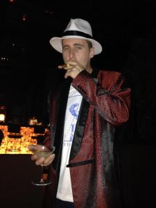 My Fiance in his Smokers Jacket and Fedora enjoying a Cigar